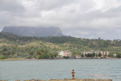 Fisherman at the bay of Baracoa - behind the mountain El Yunque